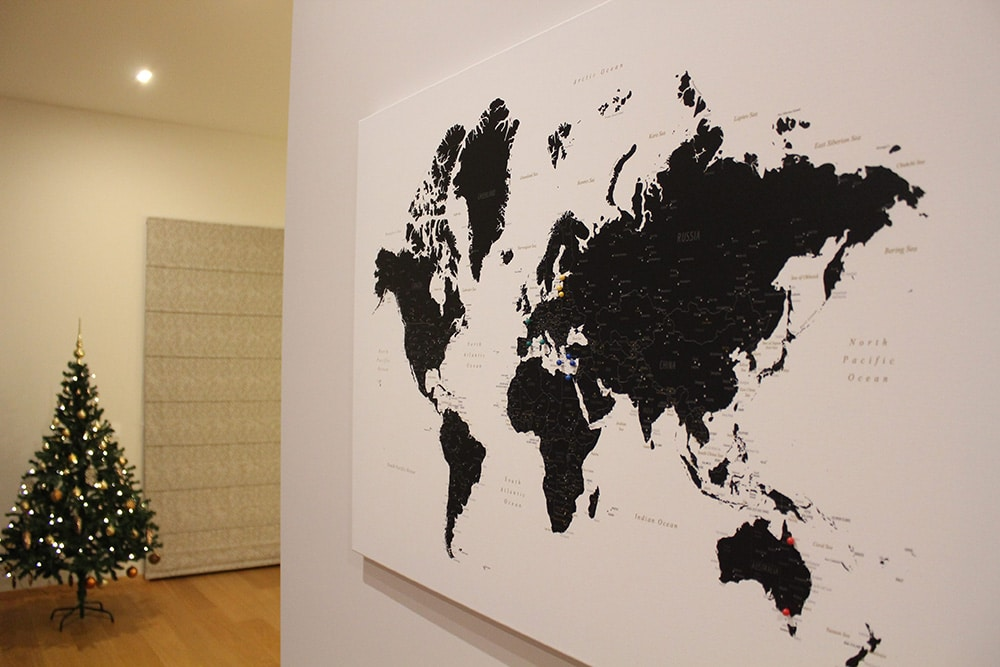 world map with pins black and white