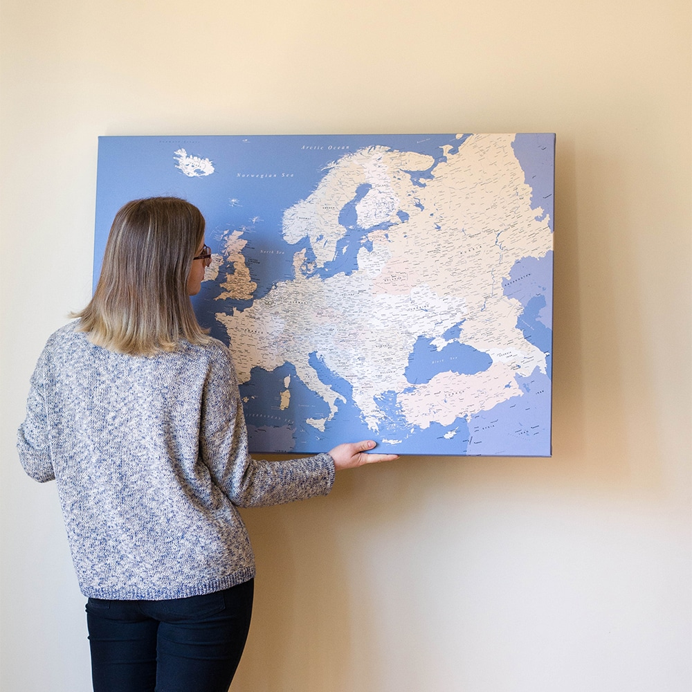 hanging a travel map with pins