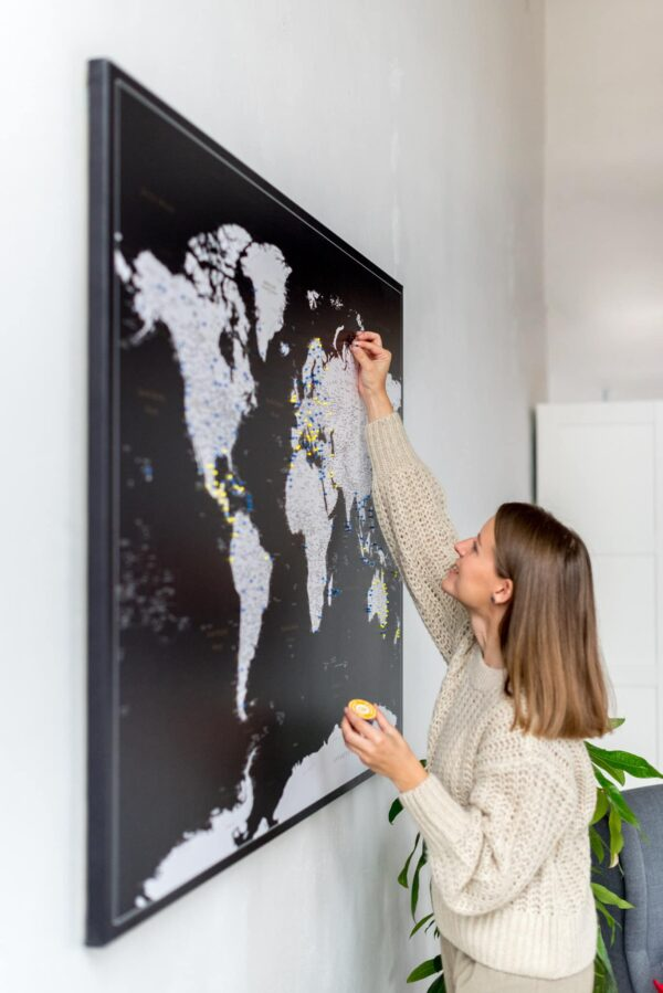 large black travel map with markers