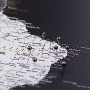 black golden colour pins on canvas map