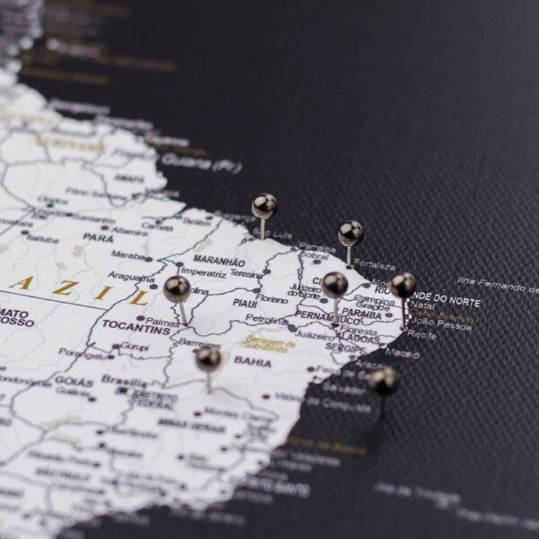 black golden colour pins on canvas map
