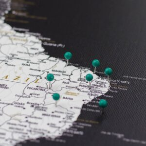 pinned dark green colour pins on canvas map
