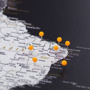 pinned orange colour pins on canvas map