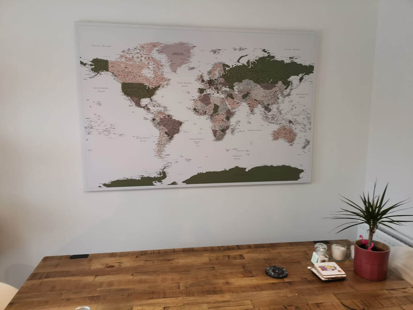 olive green world map with pins
