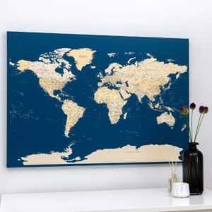 dark blue push pin world map on wall