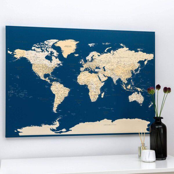 dark blue push pin world map on wall