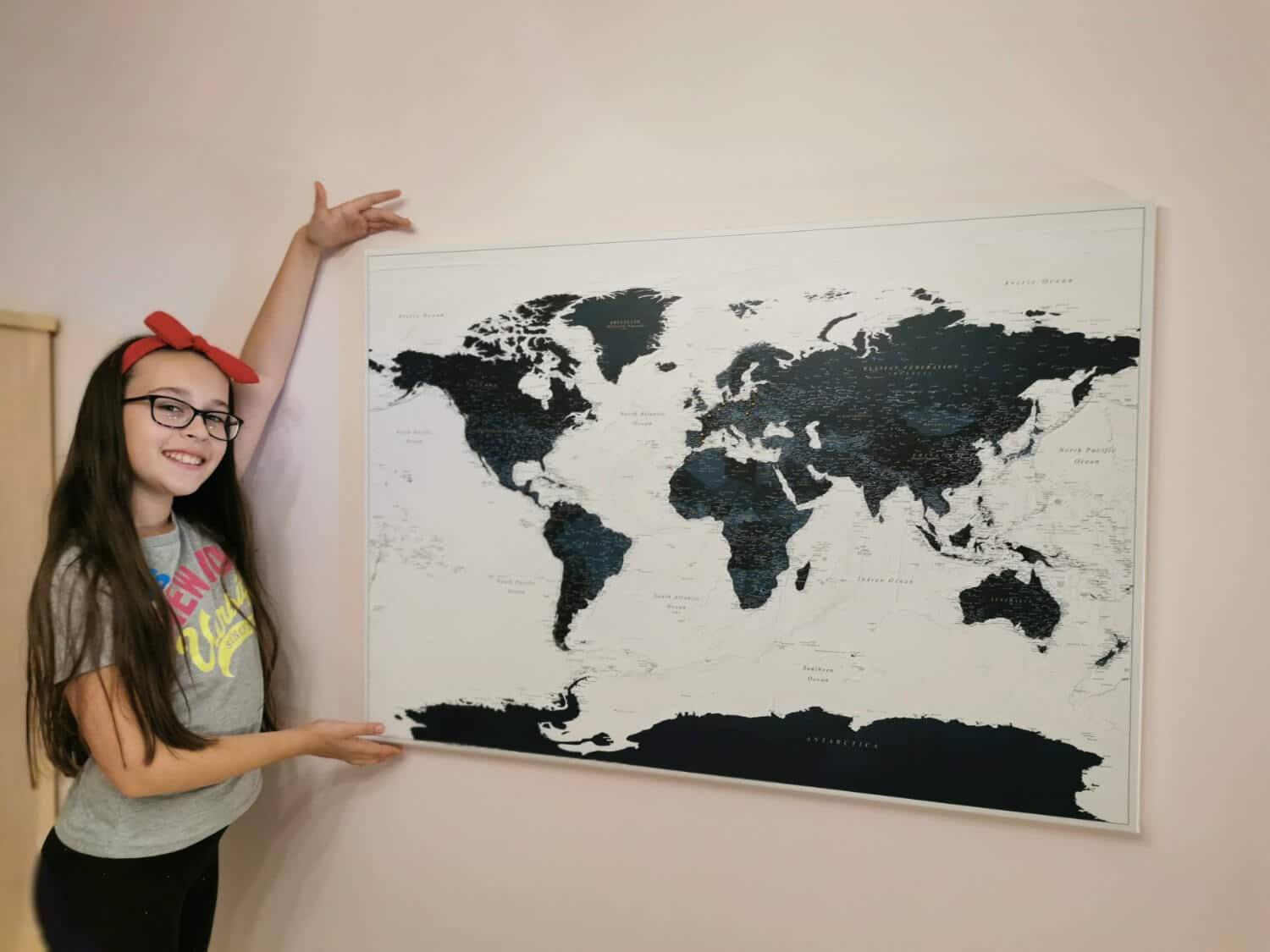 navy blue world map for family with pins